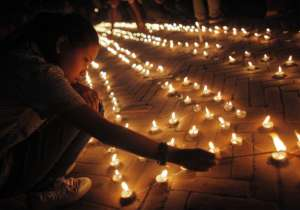 Hundreds of Nepalese today held memorial services to mark the first anniversary of last year's devastating earthquake that killed nearly 9,000 people, as victims still forced to live in tents accused the government of failing to look after them. Prime Minister K P Sharma Oli laid flowers at the demolished 19th-century Dharahara tower, where people gathered to pay homage to those killed when the 7.9-magnitude temblor struck, after a minute's silence to remember the deceased. Though the quake jolted Nepal on April 25, 2015, the memorials were being held today in its grim reminder as per the Bikram Era calendar. The quake was extremely devastating for the land-locked Himalayan nation, displacing lakhs of families besides putting a huge dent in the country's economy. - India Tv