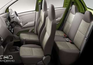 Space Since we are talking of space, the interiors can comfortably house four adults. The seatbacks of the front seats have been scooped out as well, to give the rear occupants a little more kneeroom.
