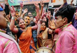 BJP workers celebrate the party's victory in the Assam assembly elections in Guwahati on Thursday.