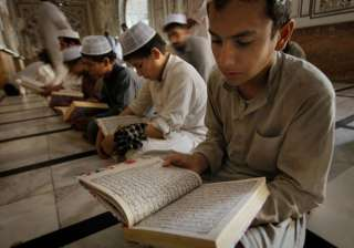 Pakistani Muslims reading the 'Quran' at a mosque during the holy fasting month of Ramadan in Peshawar, Pakistan. The fast is intended to bring the faithful closer to God and to remind them of the suffering of those less fortunate. Muslims often donate to charities during the month and feed the hungry.