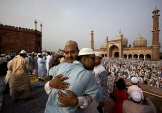Indian Muslims hug and greet each other after offering Eid al-Fitr prayers at the Jama Mosque in New Delhi. Eid al-Fitr marks the end of the Muslim holy fasting month of Ramadan.