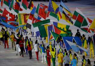Flag bearers walk into the stadium during the closing ceremony for the Summer Olympics in Rio de Janeiro, Brazil.