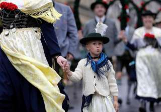 A girl participates in the traditional costume and riflemen parade on the second day of the 183rd Oktoberfest beer festival in Munich.