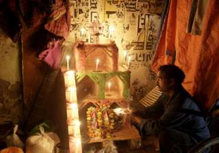 An Indian street dweller lights earthen lamps to celebrate Diwali, the Hindu festival of lights, in Allahabad, India.