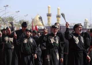 In Karbala around 80 km from Baghdad, Iraq shitte worshippers beat themselves with chains as a sign of grief for Imam Hussein. This procession took place in front of the holy shrine of Imam Abbas, seen in the background.
