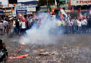BJP supporters burst crackers as early trends show the party's win in the UP and Uttarakhand assembly elections, in Ranchi.