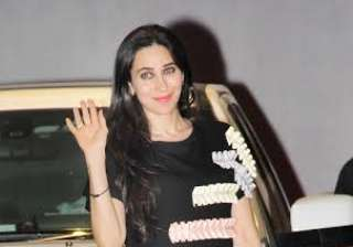 Karisma Kapoor looked fabulous in a monochrome dress as she posed for the paparazzi.
