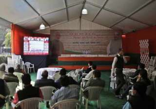 Members of India's leading Bharatiya Janata Party (BJP) watch the election result tally on a giant screen that shows their party leading in 7 and the upstart anti corruption Aam Admi Party in 62 constituencies, at their party headquarters in New Delhi.