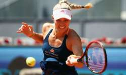 Angelique Kerber of Germany plays a forehand in her match- India Tv