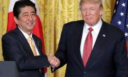 File pic - Donald Trump congratulates Japan PM Shinzo Abe