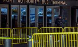 A police officer stands guard in front of Port Authority