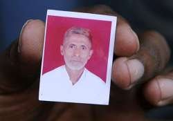 A relative showing the photograph of Mohammad Akhlaq