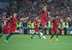 Portugal's players celebrate win against Poland in Euro
