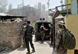 Army personnel outside the house where Sabzar Bhat was- India Tv