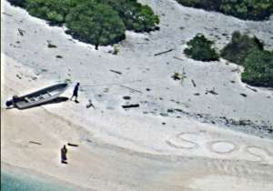 Couple rescued from remote desert island after writing SOS- India Tv