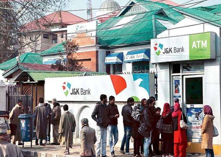 People stand in queue outside J&K bank ATM in Kashmir to- India Tv