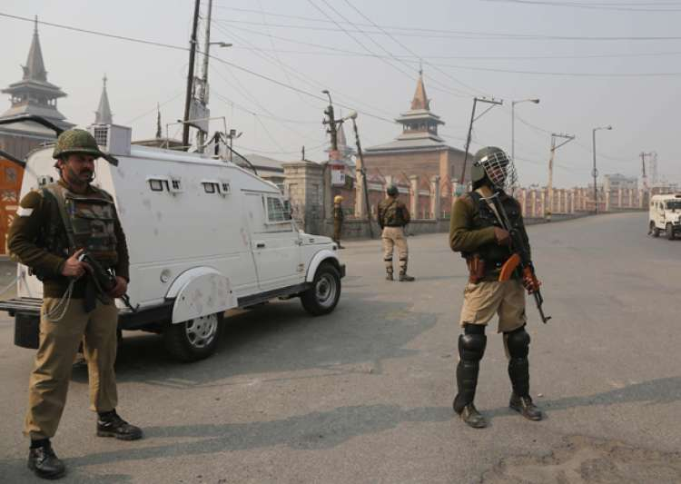 Indian paramilitary troopers stand guard outside Jamia- India Tv