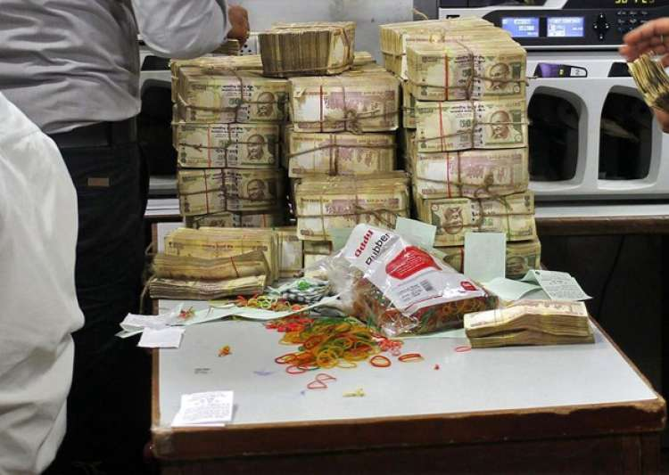 Officials count seized Rs 3.5 crore demonetised notes at- India Tv