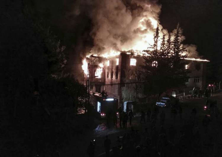 Flames rise from a fire in a school dormitory, in Aladag,- India Tv