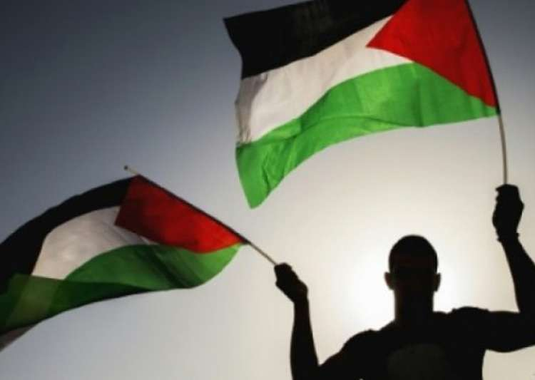 File pic - A man waves Palestinian flag - India Tv