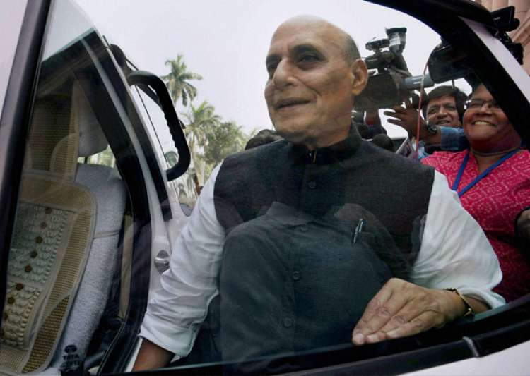 Home Minister Rajnath Singh leaves Parliament during the- India Tv