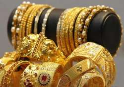gold silver slip on subdued demand global cues