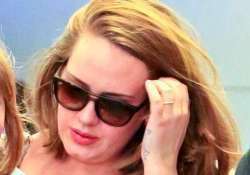adele flashes ring post split rumours