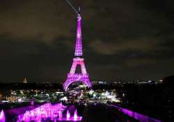in pics eiffel tower turns pink for breast cancer
