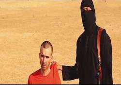 britain verifying video of aid worker s beheading
