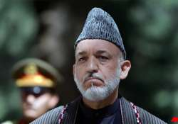 karzai reviewing taliban peace strategy spokesman