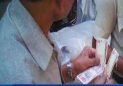 delhi cops suspended after sting op shows them taking bribe