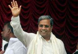 siddaramaiah inducts 28 ministers largely keeps tainted away