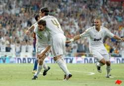 alonso rallies madrid to 2 2 draw with barcelona
