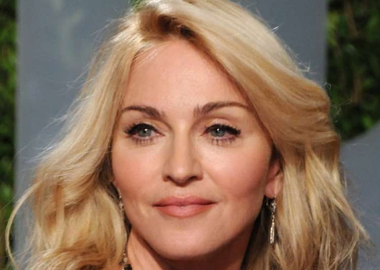 madonna settles nyc neighbour s suit over noise- India Tv