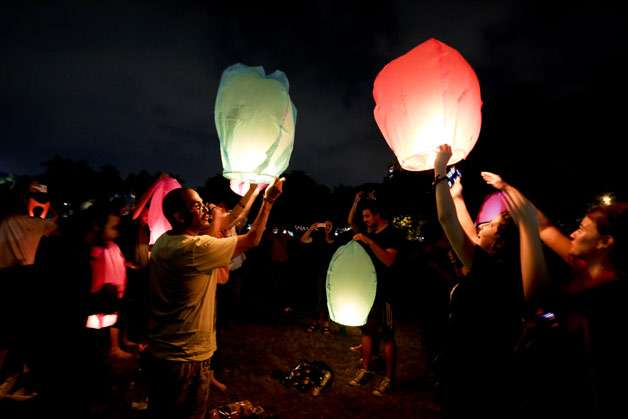 People hold sky lanterns and participate in a campaign against the use of firecrackers during Diwali festival in Kolkata, India. Hindus light lamps, wear new clothes, exchange sweets and gifts and pray to goddess Lakshmi during Diwali, the festival of lights.