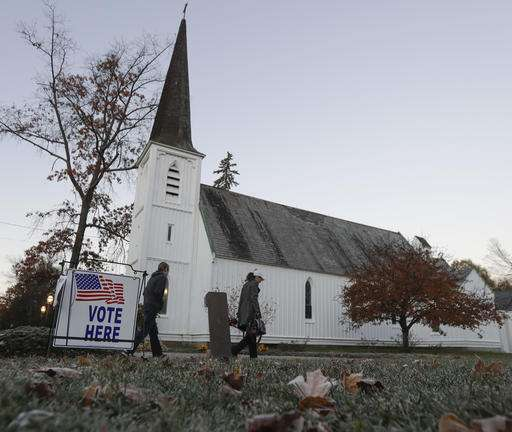 People walk to vote at St. Paul's Episcopal Church, New York. With Inputs from AP