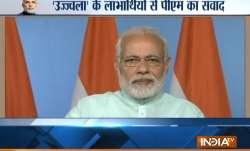 Prime Minister Narendra Modi interacts with Ujjwala scheme