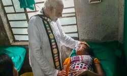 Prime Minister Narendra Modi visits a woman, who was
