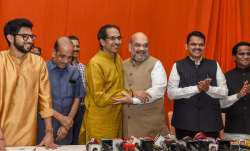 BJP President Amit Shah hugs Shiv Sena President Uddhav