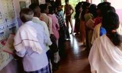 People standing at a polling booth in Kerala