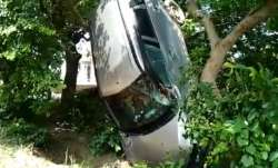 An SUV car crashed into a tree