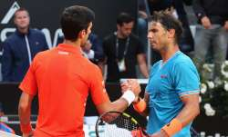 Rafael Nadal of Spain shakes the hands with Novak Djokovic