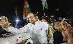 Chidambaram walks out of Tihar jail; Karti, scores of supporters welcome him