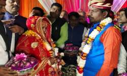 Bride and groom exchange garlands of onion, garlic