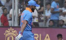 India's Virat Kohli walks back after losing his wicket