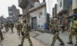 Security personnel patrol streets following clashes over the new citizenship law, in Bhagirathi area