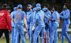 Virat Kohli of India celebrates after taking the wicket of