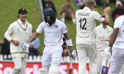 India's Virat Kohli, second left, walks from the field