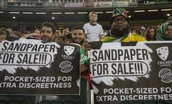 Fans hold posters during the 1st T20 cricket match between