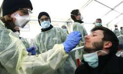 German medical employees demonstrate testing at a
